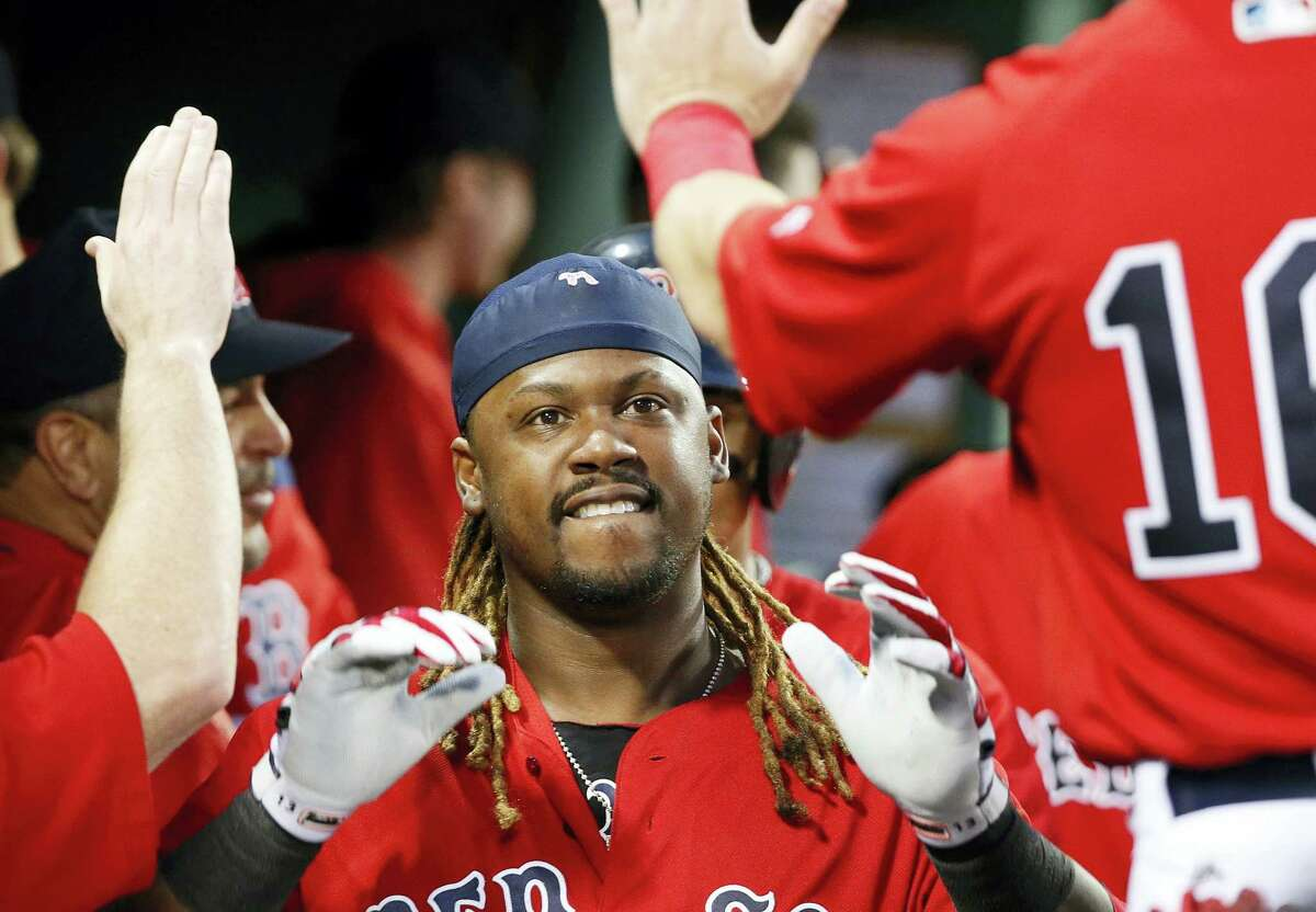 Boston Red Sox's Hanley Ramirez celebrates his two-run home run during the third inning of a baseball game against the New York Yankees in Boston, Friday.