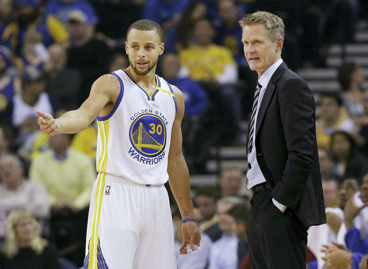 Golden State Warriors guard Stephen Curry (30) talks with head coach Steve Kerr during the first half of an NBA basketball game against the Detroit Pistons in Oakland, Calif. on Jan. 12, 2017.