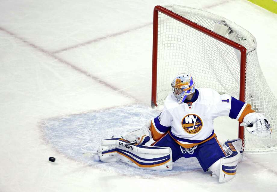 Islanders goalie Thomas Greiss guards the net in the first period on Monday. Photo: Elise Amendola — The Associated Press  / Copyright 2017 The Associated Press. All rights reserved.