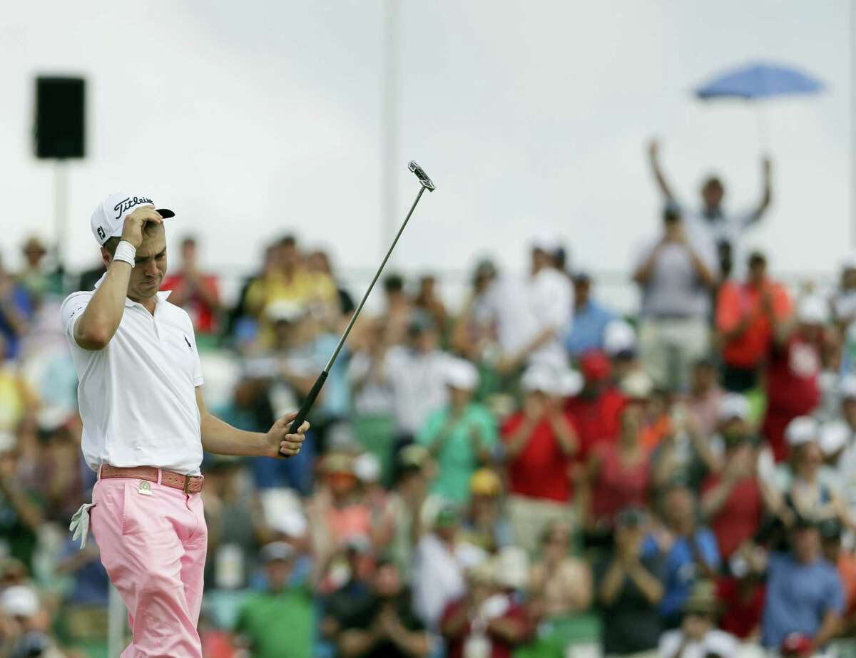 Justin Thomas reacts after making his eagle putt on the 18th hole during the third round of the U.S. Open on Saturday.