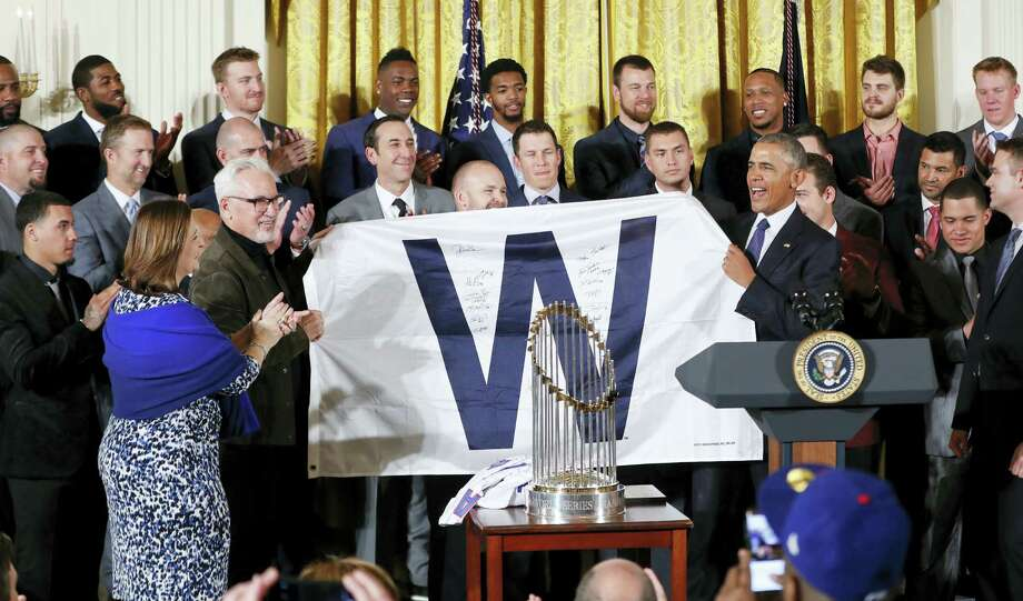 President Barack Obama holds up a 'W' flag signed by the Cubs during a ceremony in the East Room of the White House in Washington on Monday. Photo: Pablo Martinez Monsivais — The Associated Press  / Copyright 2017 The Associated Press. All rights reserved.