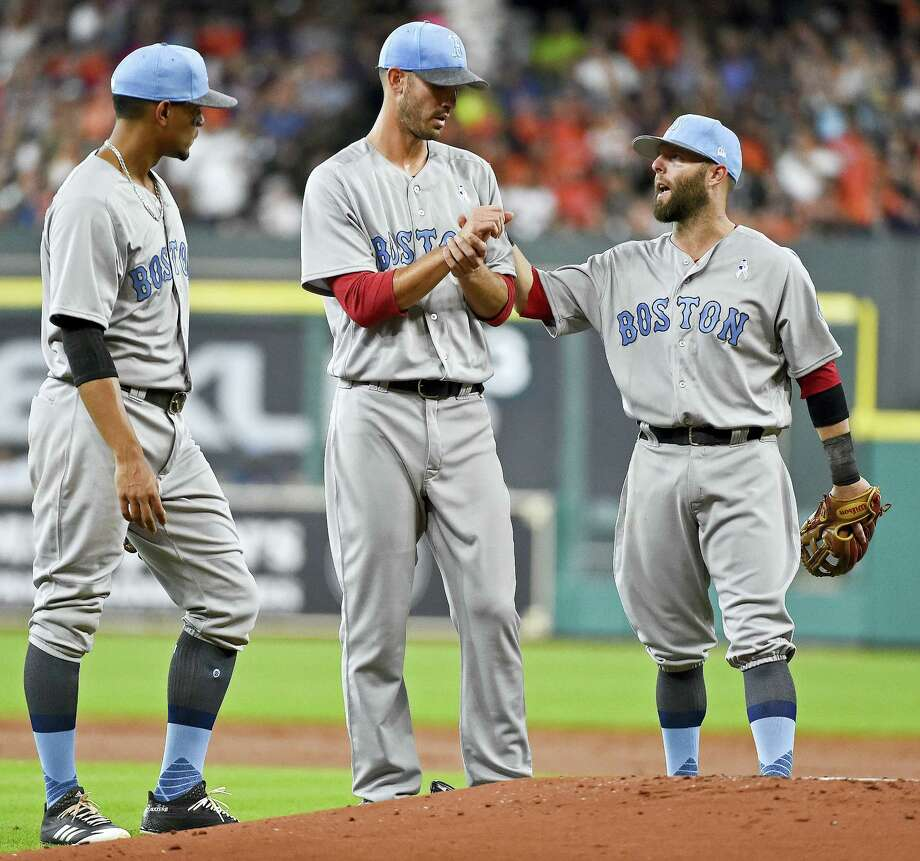 Red Sox second baseman Dustin Pedroia, right, talks with starting pitcher Rick Porcello, center, as shortstop Xander Bogaerts looks on during Saturday's game in Houston. Photo: Eric Christian Smith — The Associated Press  / FR171023 AP