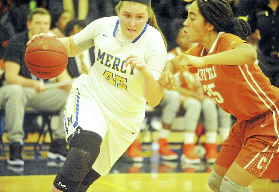 Mercy junior Meghan DeVille drives past Capital Prep's Cassandra Hawthorne on Monday. Photo: Jimmy Zanor - The Middletown Press