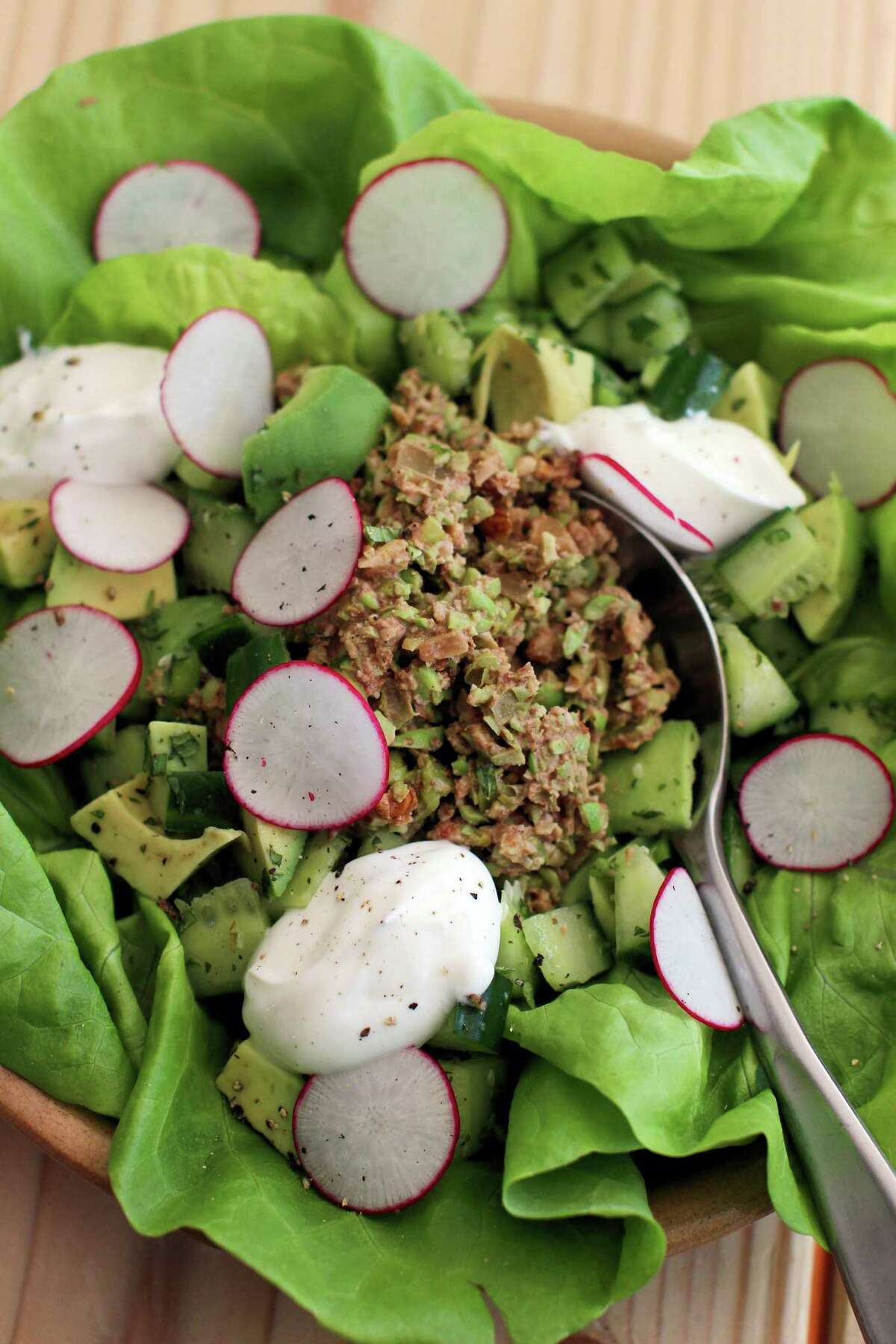 """Edamame and walnut lettuce wraps pair firm soybeans with crunchy walnuts and some spices to make a cold vegetarian """"meat"""" for lettuce wraps or tacos."""