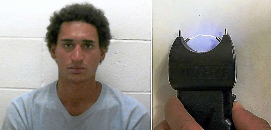 Samuel Schultz and the stun gun he allegedly dropped at the scene of a burglary over the weekend. Clinton police say Schultz broke into several area homes and vehicles. Photo: Courtesy Clinton Police