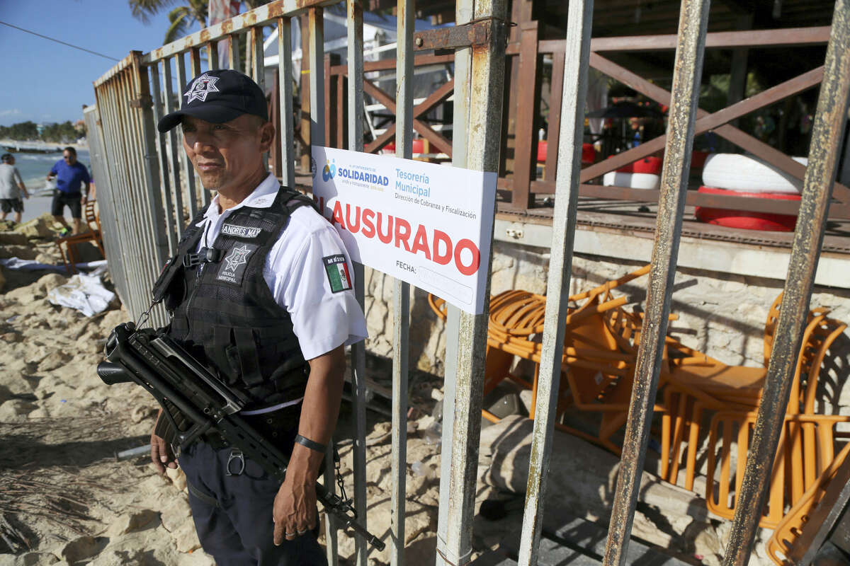 Police guard the exit of the Blue Parrot nightclub in Playa del Carmen, Mexico, Monday, Jan. 16, 2017. A deadly shooting occurred in the early morning hours outside the nightclub while it was hosting part of the BPM electronic music festival, according to police. (AP Photo)