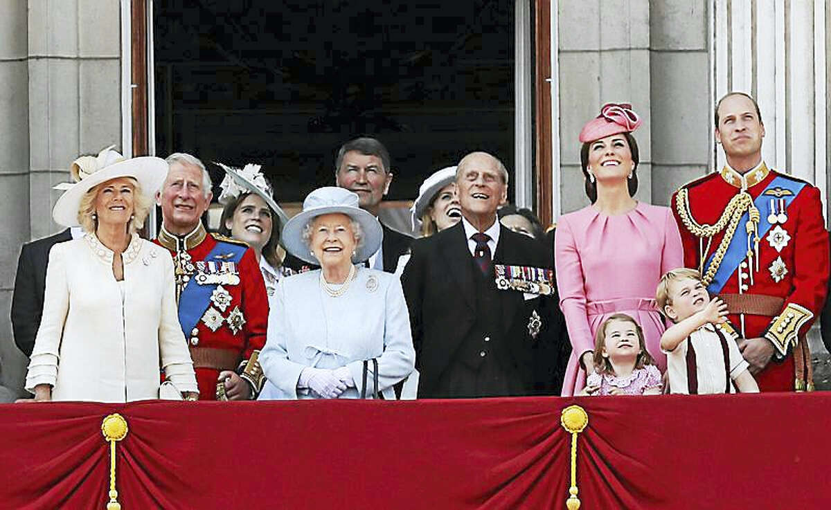 """The royal family watches a """"fly past"""" after Trooping the Color ceremony Saturday at Buckingham Palace."""