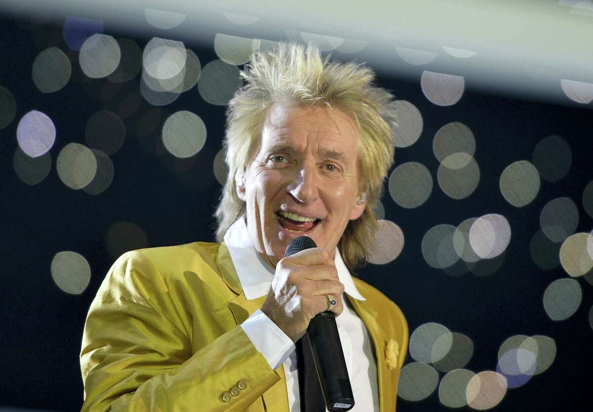 FILE - This Nov. 28, 2015, file photo shows singer Rod Stewart performing in the Esprit Arena in Duesseldorf, western Germany. Many of the rock 'n' roll bands that were huge in 1977 will comprise a big part of the summer concert market 40 years later. Stewart is among those launching major tours this spring and summer.