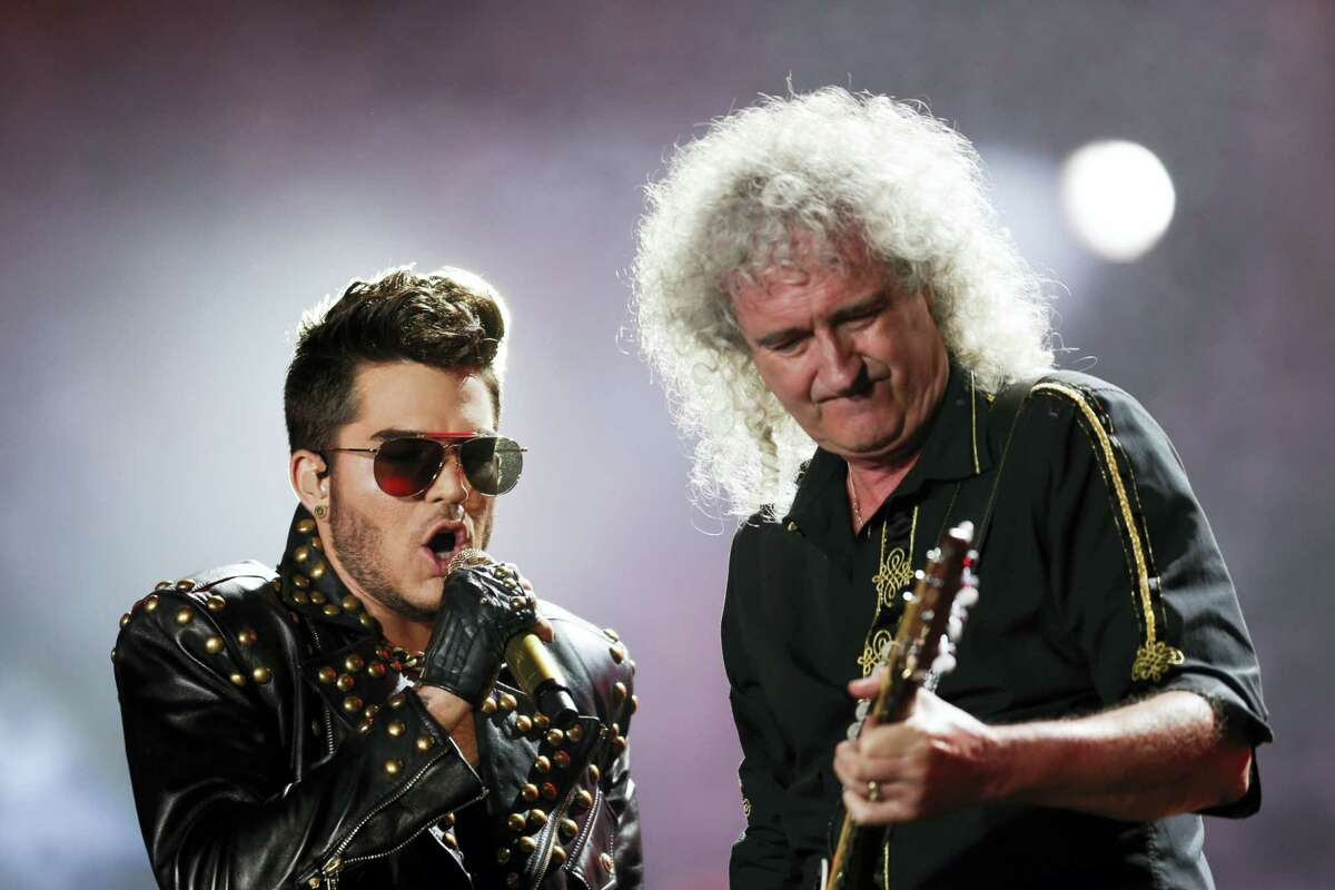 FILE - In this Sept. 19, 2015 file photo, Adam Lambert, left, and Brian May of the Queen + Adam Lambert perform at the Rock in Rio music festival in Rio de Janeiro, Brazil. Many of the rock 'n' roll bands that were huge in 1977 will comprise a big part of the summer concert market 40 years later. Concert industry executives say nostalgia acts are still reliable sellers, with satellite and classic rock radio keeping their hits alive.
