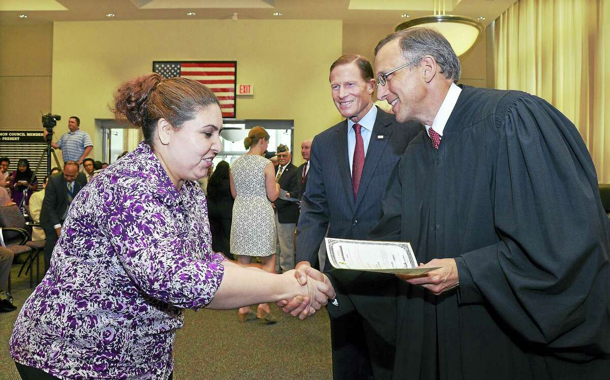 File photo New citizens register to vote following the city's annual naturalization ceremony at Middletown City Hall in this file photograph. Mayor Dan Drew declared the city a safe haven for immigrants last week, saying local law enforcement will not do the U.S. government's job by enforcing federal immigration laws following President Donald J. Trump's executive order of Jan. 27.