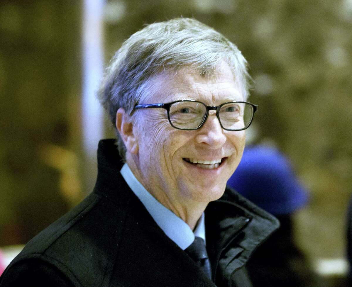 In this Dec. 13, 2016 photo, Bill Gates arrives to Trump Tower in New York. The eight individuals who own as much as half of the rest of the planet are all men, and have largely made their fortunes in technology. Gates co-founded Microsoft in the mid-70s, growing it into the world's biggest software company and helping to make computers a household item.