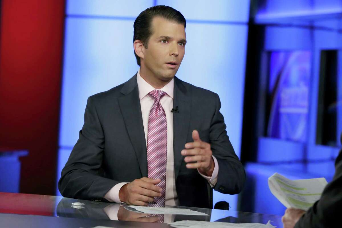 In this photo taken July 11, 2017, Donald Trump Jr. is interviewed by host Sean Hannity on his Fox News Channel television program, in New York. A Russian-American lobbyist says he attended a June 2016 meeting with President Donald Trump's son, marking another shift in the account of a discussion that was billed as part of a Russian government effort to help the Republican's White House campaign.