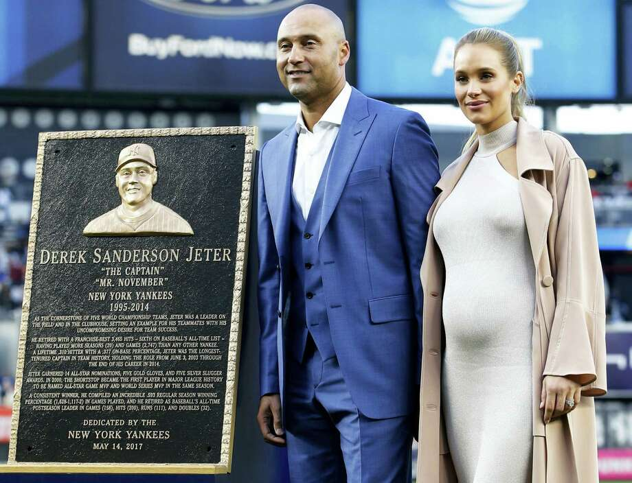 Retired Yankees shortstop Derek Jeter and his wife Hannah Jeter stand beside his Monument Park plaque during a pregame ceremony Sunday. Photo: Kathy Willens — The Associated Press   / Pool