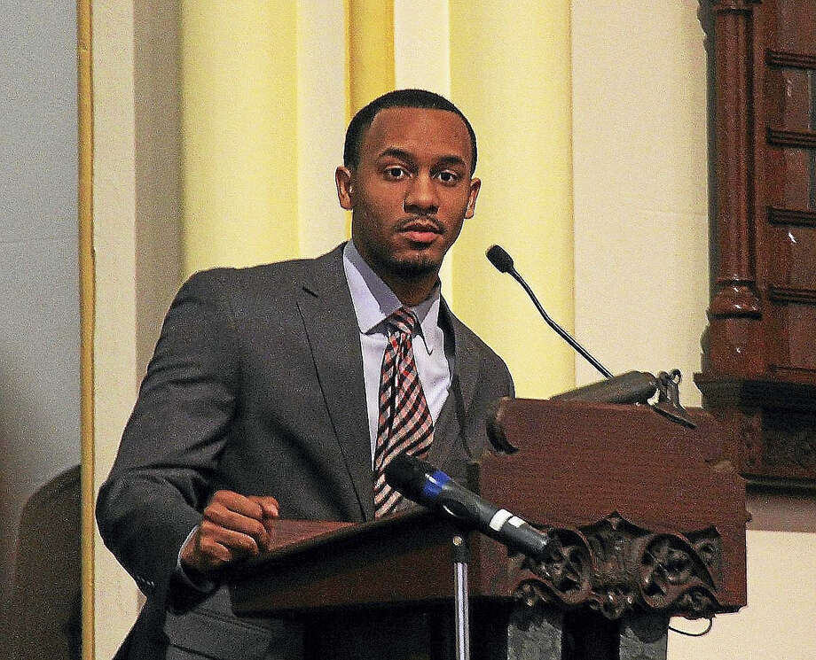 Trey James, a 2008 winner of the Martin Luther King Jr. Scholarship, speaks Monday at South Congregational Church during the 24th annual Martin Luther King Jr. birthday celebration in Middletown. Photo: Kathleen Schassler— The Middletown Press  / Kathleen Schassler All Rights