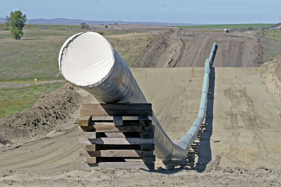 A section of the Dakota Access Pipeline under construction near the town of St. Anthony in Morton County, N.D. in 2016. The Army has notified Congress Tuesday, Feb. 7, 2017, that it will allow the $3.8 billion Dakota Access pipeline to cross under a Missouri River reservoir in North Dakota, completing the four-state project to move North Dakota oil to Illinois. The Army intends to allow the crossing under Lake Oahe as early as Wednesday, Feb. 8. The crossing is the final big chunk of work on the pipeline.   Tom Stromme — The Bismarck Tribune via AP, File Photo: AP / The Bismarck Tribune