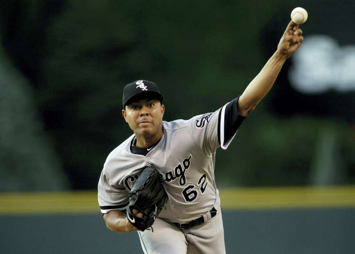 In this July 8, 2017 photo, Chicago White Sox starting pitcher Jose Quintana delivers against the Colorado Rockies in the first inning of a baseball game, in Denver. The Chicago Cubs acquired left-handed pitcher Jose Quintana from the Chicago White Sox for outfielder Eloy Jimenez, right-handed pitcher Dylan Cease, and infielders Matt Rose and Bryant Flete on July 13, 2017.