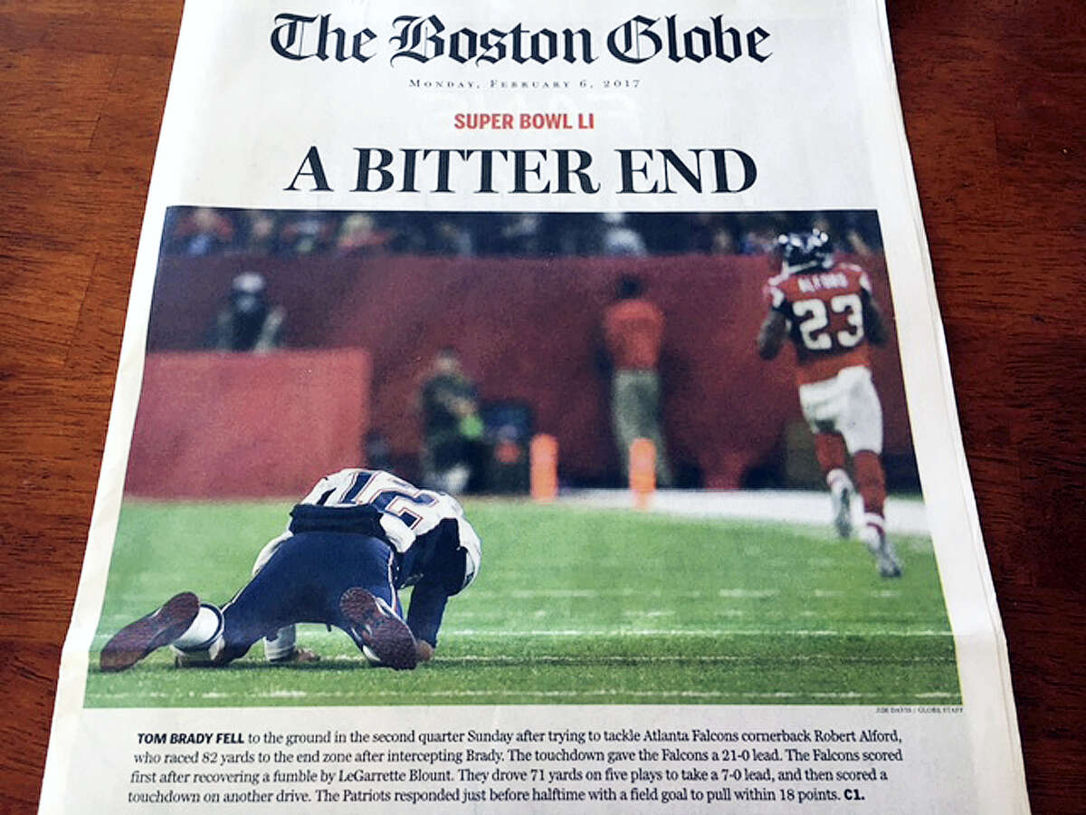 This Monday photo provided by Mary Tivnan shows a front page of an early edition of The Boston Globe in North Fort Myers, Fla.