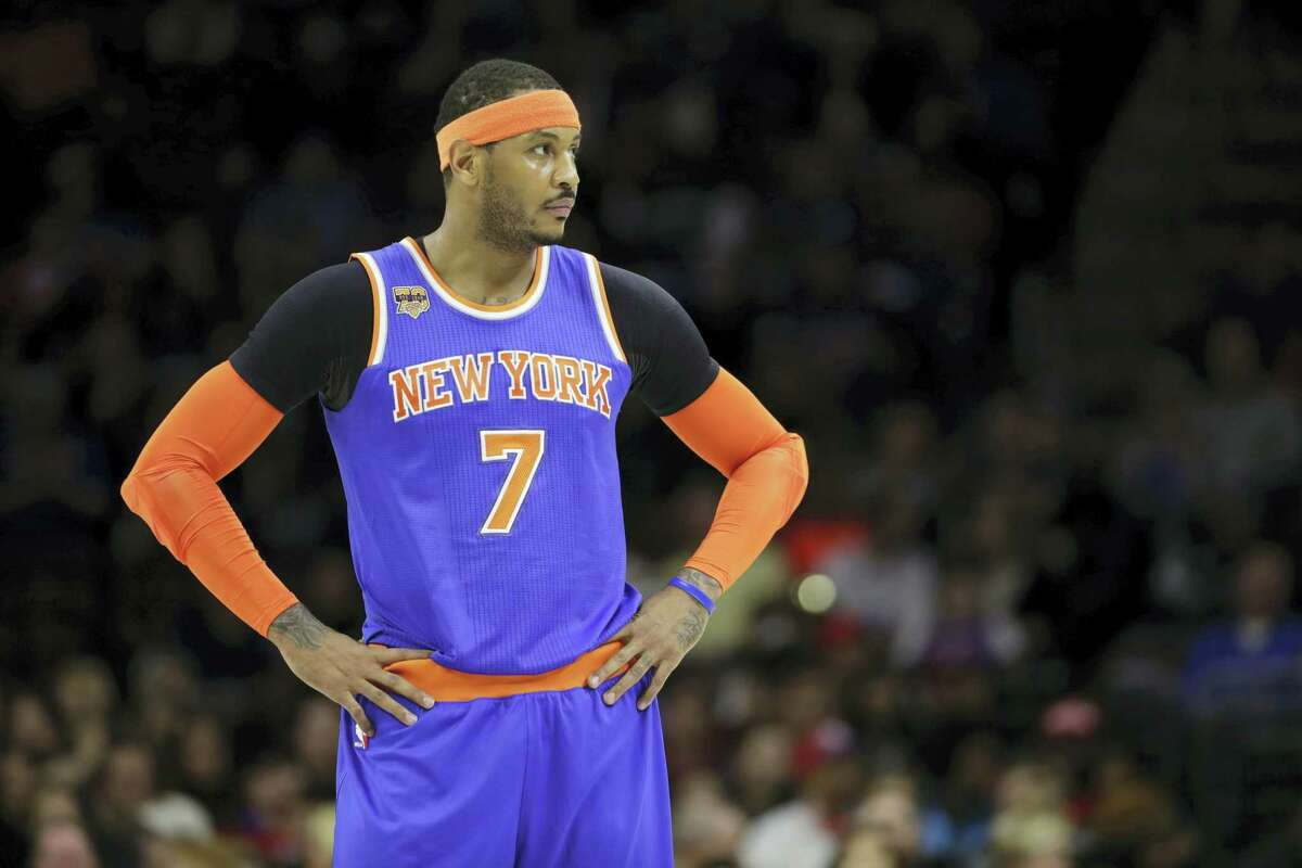 In this March 3, 2017 photo, New York Knicks' Carmelo Anthony is shown during an NBA basketball game against the Philadelphia 76ers, in Philadelphia. The New York Knicks and Houston Rockets continue talking about a trade for Carmelo Anthony, though a person with knowledge of the details says no deal is imminent. Anthony has told the Knicks he would accept a move to the Rockets but the teams are still trying to find a trade that works for both sides, the person told The Associated Press on July 13, 2017.