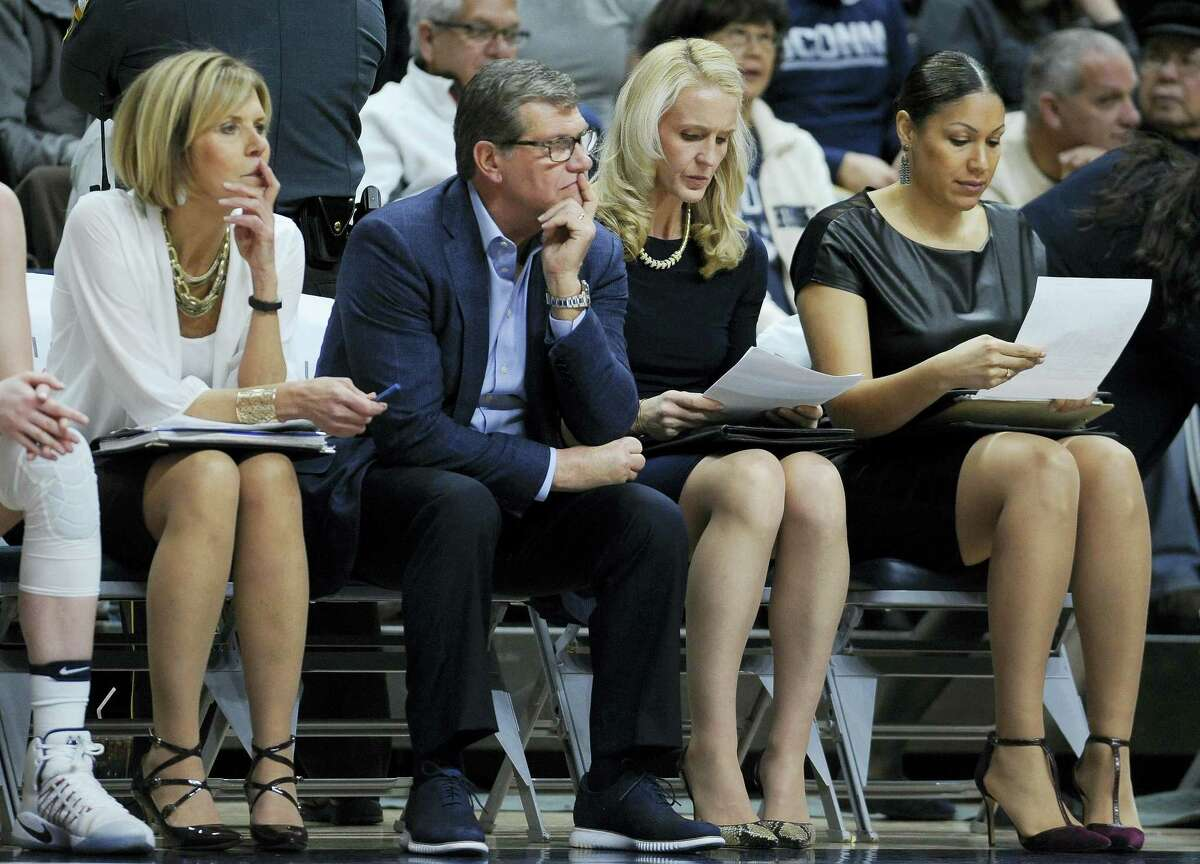 UConn head coach Geno Auriemma, second from left, has been a little bit surprised with the Huskies success on the road this season.