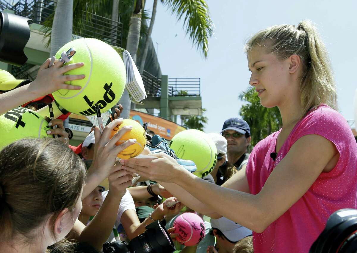 Tennis star Genie Bouchard signs autographs for fans.