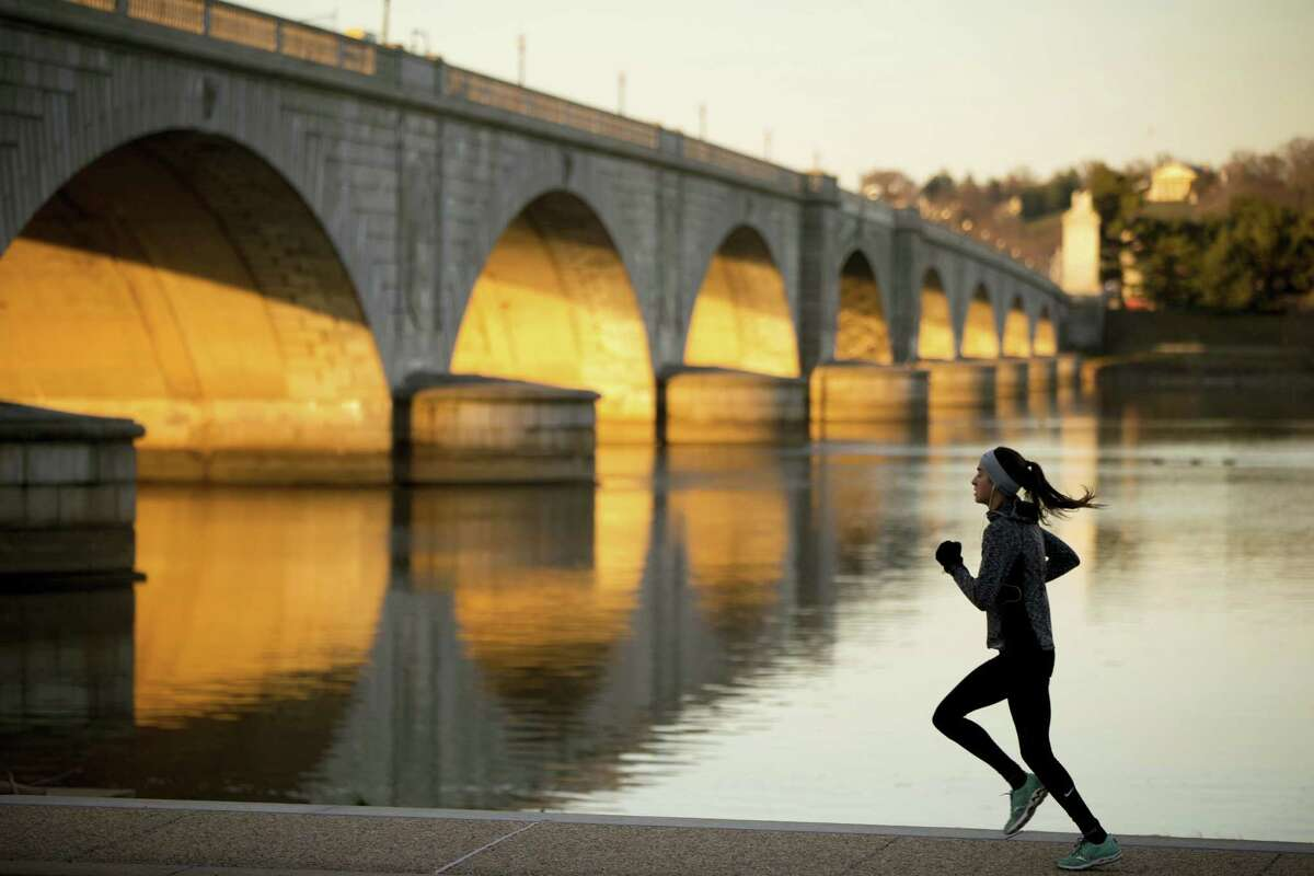 In this March 3, 2016 photo, a jogger passes by the Arlington Memorial Bridge at sunrise in Washington. Donald Trump talked during his campaign about making America's infrastructure great again, and his inauguration will put the spotlight on some glaring needs in the nation's capital.