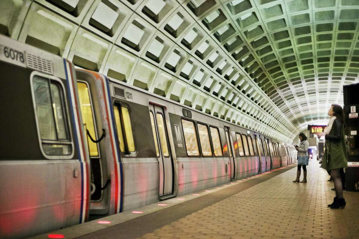 In this March 12, 2015 photo, passengers wait on the platform before boarding a train at the U Street Metro Station in Washington. Americans visiting Washington for his inauguration will get a first-hand look at the country's needs when traveling on the city's beleaguered subway.