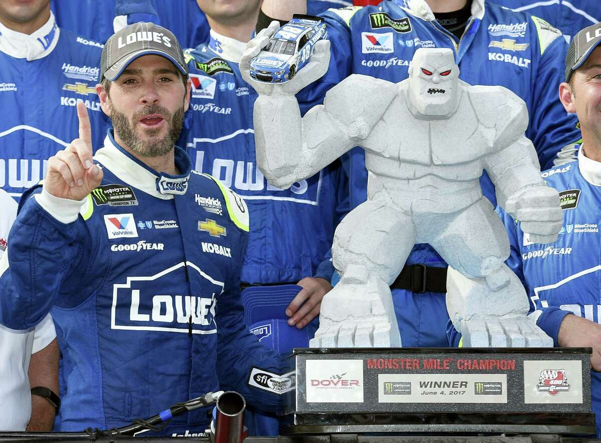 Jimmie Johnson, left, poses in Victory Lane after a win at Dover International Speedway earlier this season.