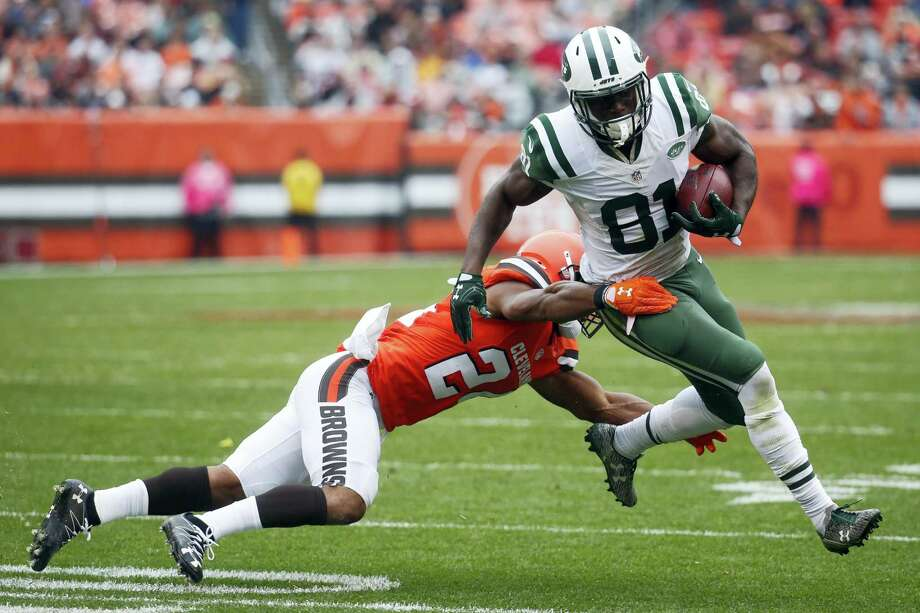 Jets wide receiver Quincy Enunwa (81) breaks a tackle by Browns strong safety Ibraheim Campbell during a game last season. Photo: The Associated Press File Photo  / AP