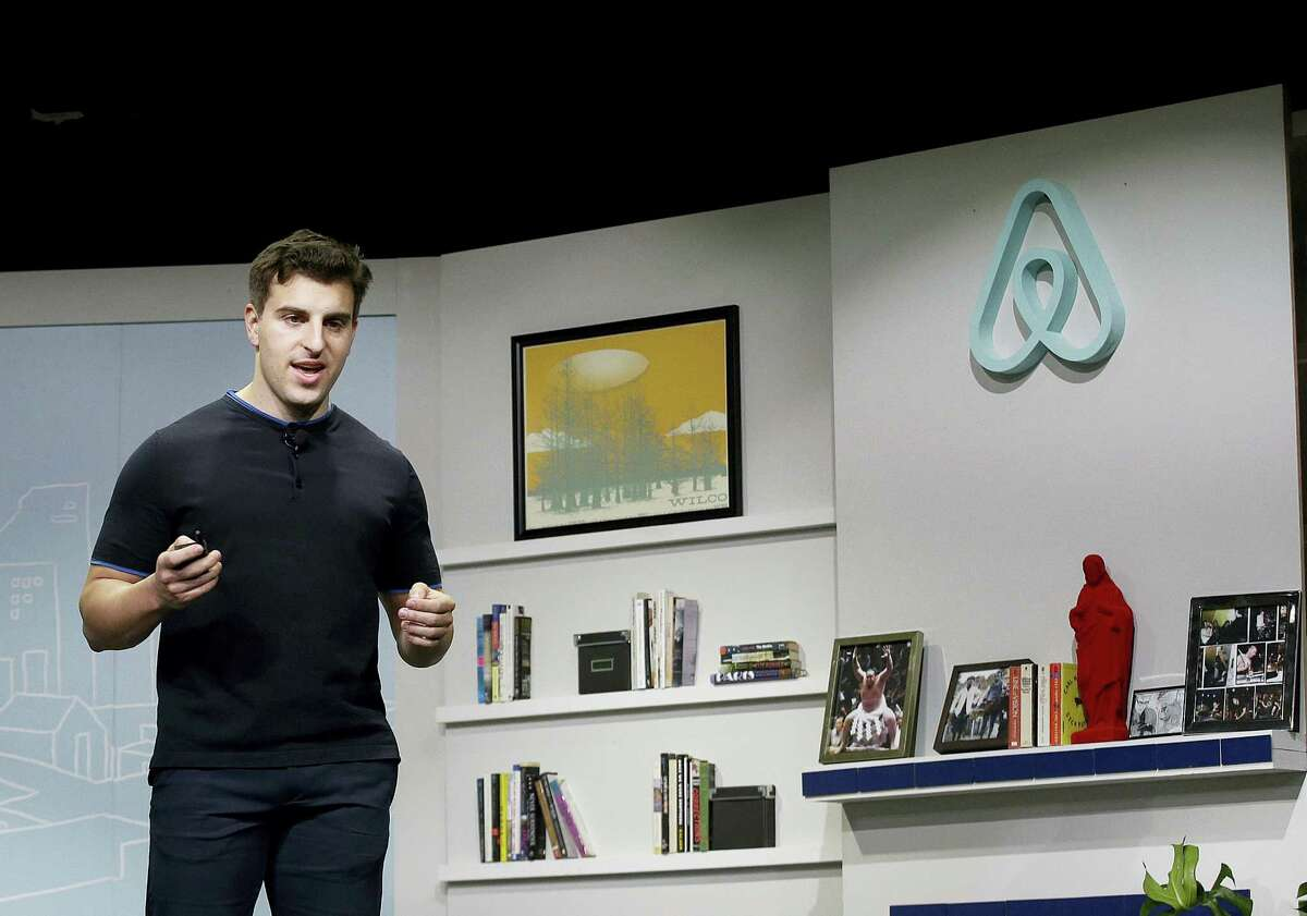 In this April 19, 2016 photo, Airbnb co-founder and CEO Brian Chesky speaks during an event in San Francisco. Airbnb is following up its Super Bowl ad on Feb. 5, 2017, calling for acceptance with a campaign to provide short-term housing over the next five years for 100,000 people in need.