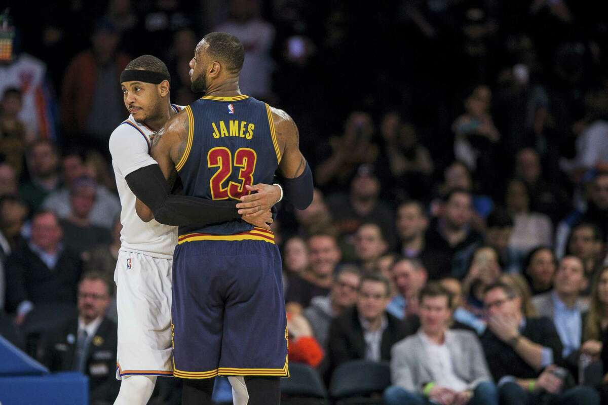 New York Knicks' Carmelo Anthony, left. guards Cleveland Cavaliers' LeBron James during the second half of an NBA basketball game on Feb. 4, 2017 in New York.