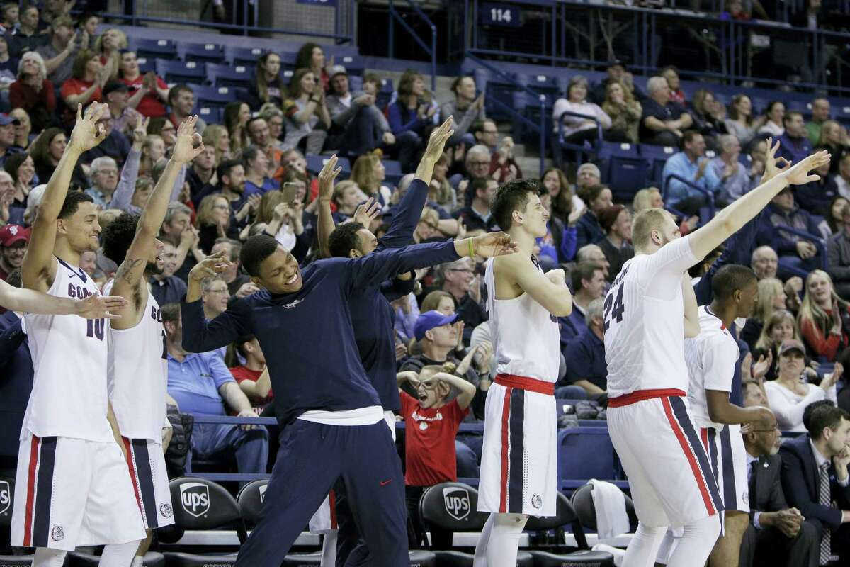 Gonzaga players celebrate during the second half of a win over Santa Clara on Saturday.