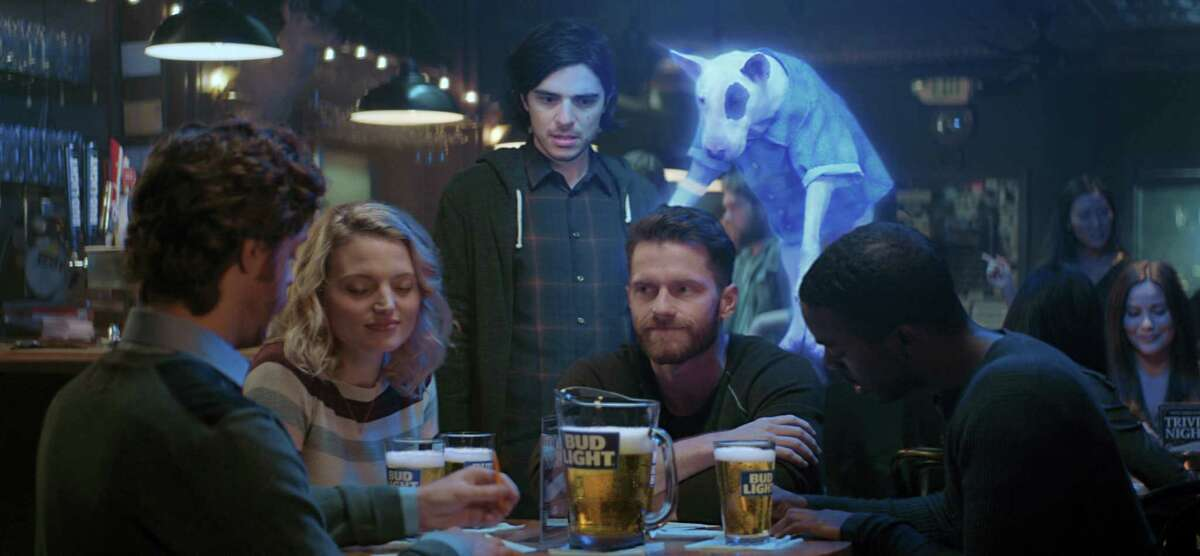 This photo provided by Bud Light shows a scene from the company's 'ÄúGhost Spuds,'Äù spot for Super Bowl 51, between the New England Patriots and Atlanta Falcons, Sunday. Bud Light is re-introducing the brand'Äôs 'Äô80s pop culture icon and man'Äôs best friend, Spuds MacKenzie.