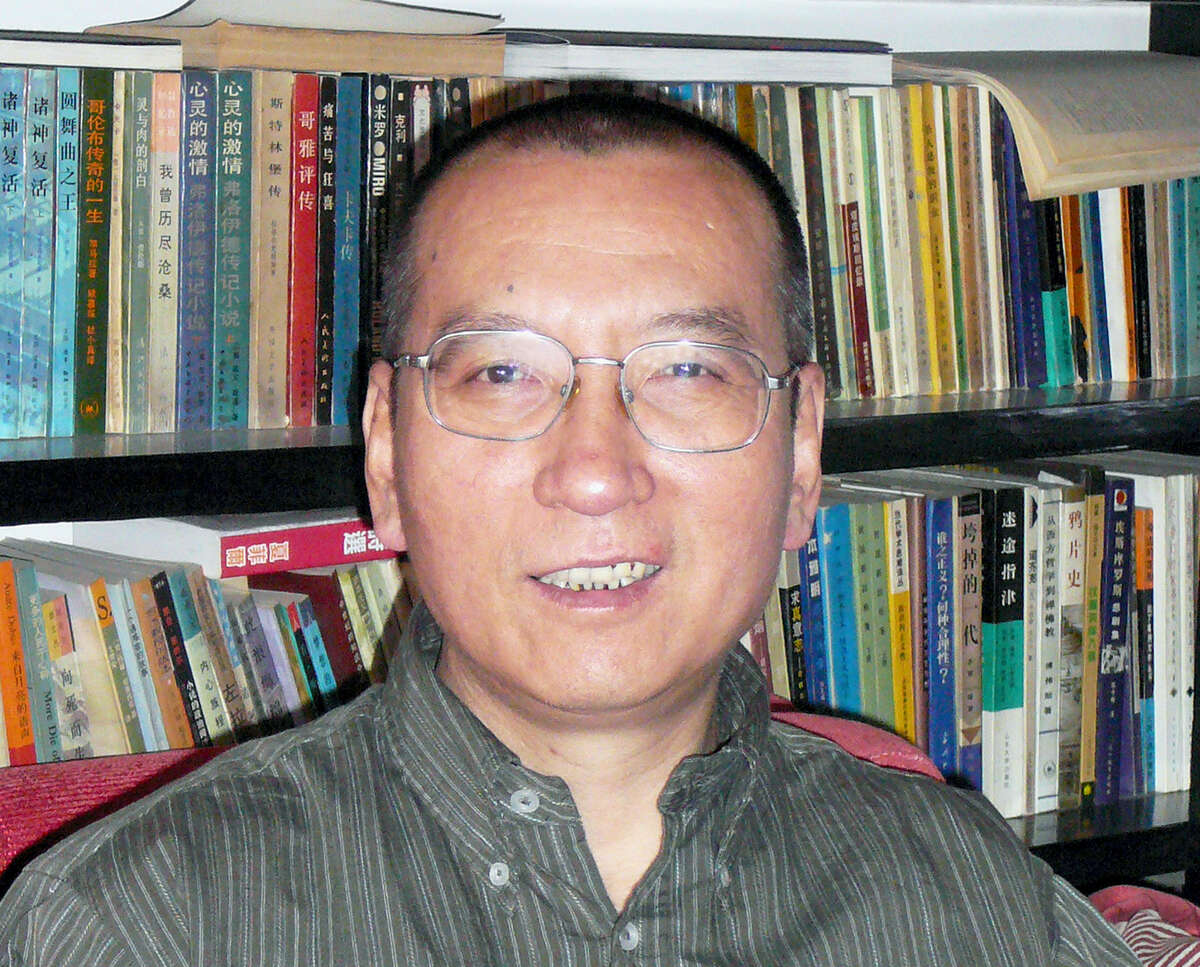 FILE - In this April 2008 file photo shows Chinese dissident Liu Xiaobo as he poses for a photographer in China. The judicial bureau in the northeastern Chinese city of Shenyang says jailed Nobel Peace Prize laureate Liu Xiaobo has died of multiple organ failure Thursday, July 13, 2017, at age 61. (AP Photo/Kyodo News, File)