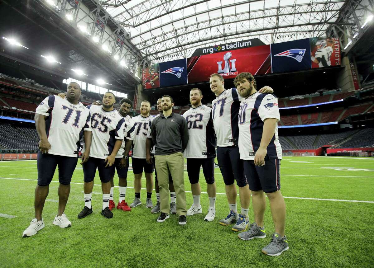 New England Patriots players pose for a photo during a walk through at NRG Stadium, site of the NFL Super Bowl 51 football game on Feb. 4, 2017 in Houston. The Patriots will face the Atlanta Falcons in the Super Bowl Sunday.