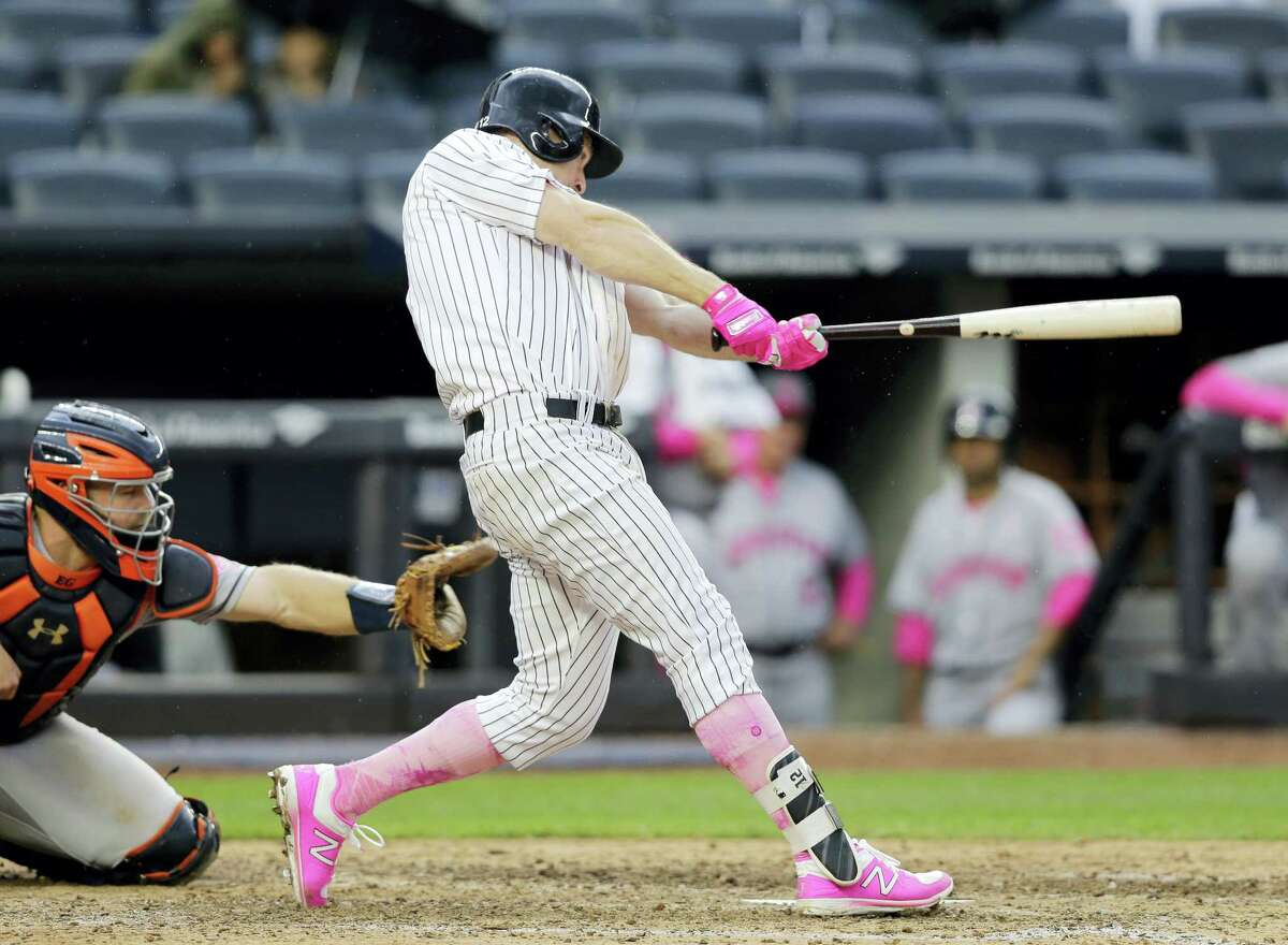 The Yankees' Chase Headley hits a three-run home run during the seventh inning Sunday.