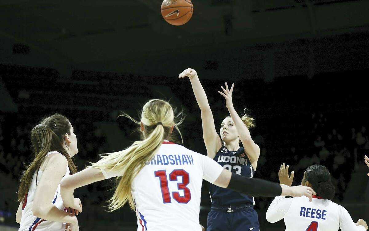 UConn's Katie Lou Samuelson takes a shot as SMU's Alicia Froling (10), Klara Bradshaw (13) and Mikayla Reese (4) defend during the first half on Saturday.