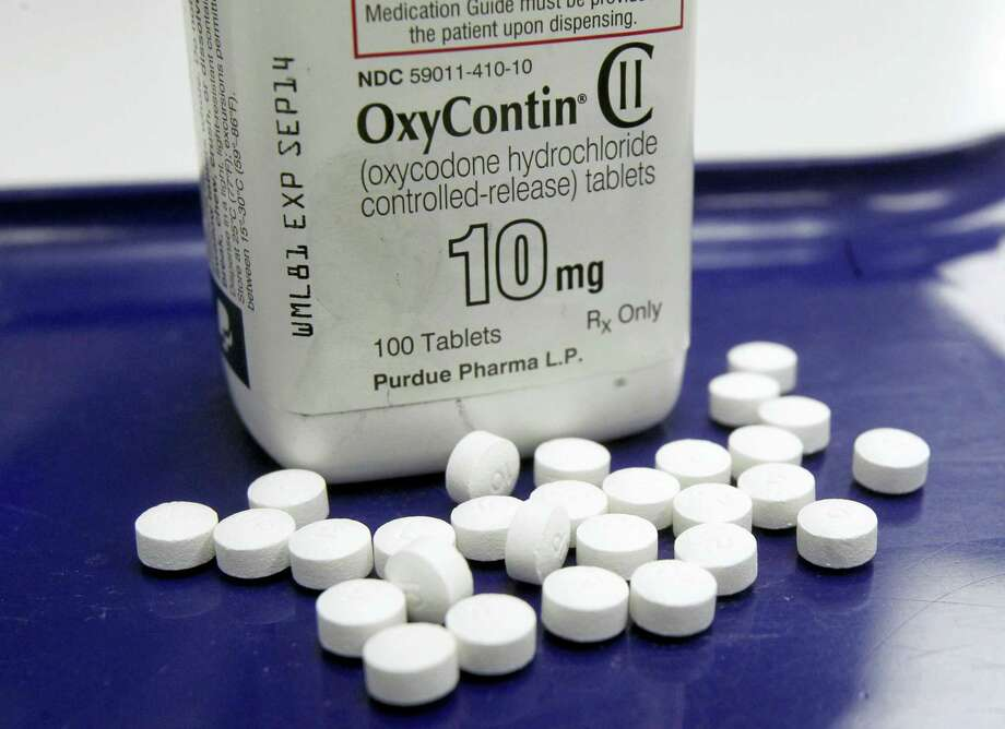 This Feb. 19, 2013, file photo, shows OxyContin pills arranged for a photo at a pharmacy in Montpelier, Vt. More than 28,000 Americans died from overdosing on opiates in 2014, a record high for the nation. Photo: AP Photo/Toby Talbot / Copyright 2016 The Associated Press. All rights reserved. This material may not be published, broadcast, rewritten or redistribu
