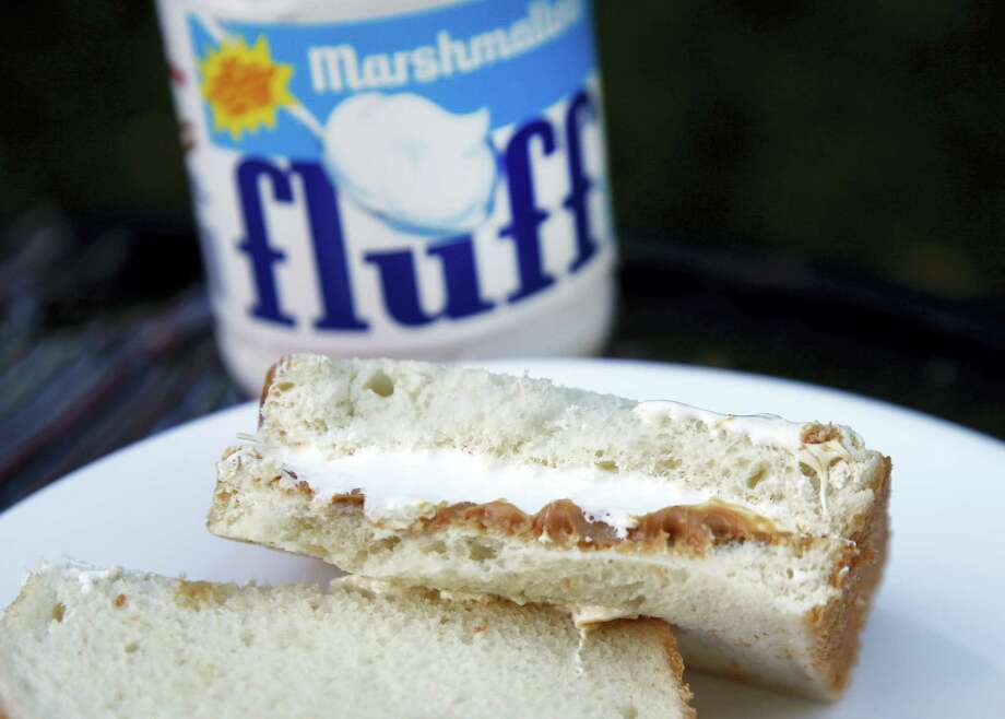 In this Sept. 27, 2013 photo, a jar of Marshmallow Fluff and a Fluffernutter sandwich are displayed in North Andover, Mass. Archibald Query invented Fluff in 1917 in the Boston suburb of Somerville. The marshmallow concoction that's been smeared on a century's worth of sandwiches has inspired a festival and other sticky remembrances as it turns 100 in 2017. Photo: AP Photo/Elise Amendola, File  / Copyright 2017 The Associated Press. All rights reserved.