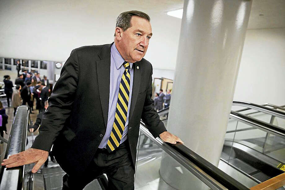 In this April 7, 2017, file photo, U.S. Sen. Joe Donnelly, D-Ind., arrives for the confirmation vote for Supreme Court nominee, Neil Gorsuch, on Capitol Hill in Washington. Donnelly railed against Carrier Corp. for moving manufacturing jobs to Mexico last year, even while he profited from a family business that relies on Mexican labor to produce dye for ink pads, according to records reviewed by The Associated Press. Photo: AP Photo/J. Scott Applewhite, File   / Copyright 2017 The Associated Press. All rights reserved.