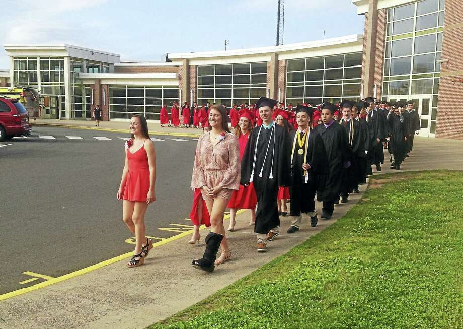 Portland High School graduated 97 students on Thursday evening. Photo: Jeff Mill — Hearst Connecticut Media