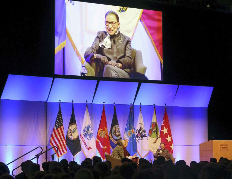 U.S. Supreme Court Justice Ruth Bader Ginsburg, shown on the screen and seated at right, on stage in Cameron Hall at Virginia Military Institute in Lexington, Va., Wednesday. Photo: Stephanie Klein-Davis — The Roanoke Times Via AP  / The Roanoke Times