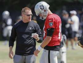 Raiders' offensive coordinator Todd Downing with quarterback Connor Cook during practice at Oakland Raiders training camp in Napa, Ca., on Wed. August 9, 2017.