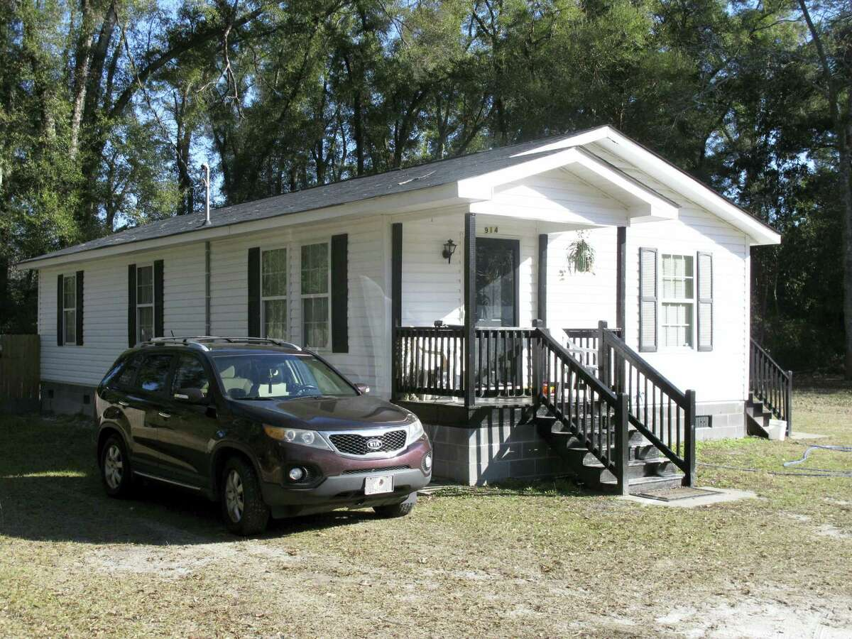 The exterior of a home in Walterboro, S.C. where Gloria Williams lived for years with a girl that authorities say was kidnapped as an infant 18 years ago from a hospital in Florida. Williams was arrested and charged with kidnapping and interference with custody.