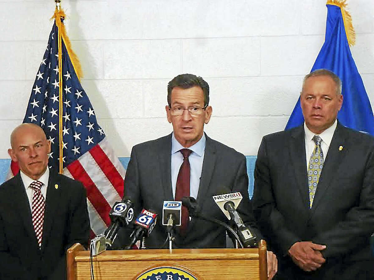 From left, Warden Jose Feliciano, Gov. Dannel P. Malloy and Commissioner Scott Semple introduce the new program at New Haven Correctional Center.