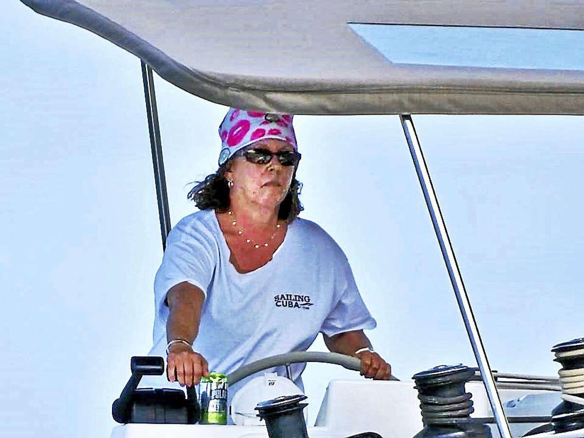 Capt. Joy Sherman maneuvering boat into the slip at Marina Hemingway after clearing customs.