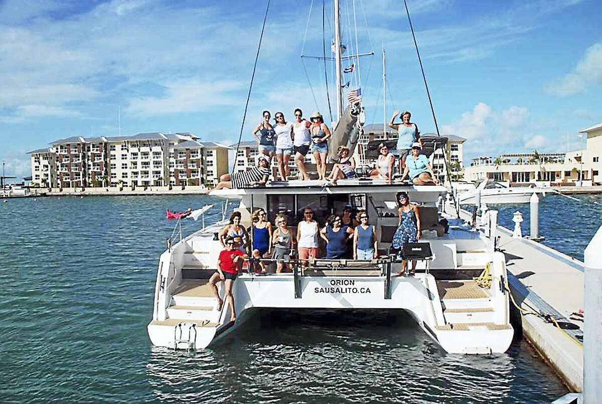 The historic all-women crew on catamaran skippered by Capt. Joy Sherman with backdrop of Varadero, a beach community midway between Key West and Havana.
