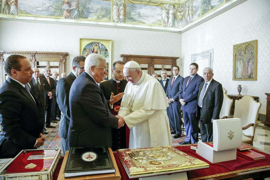 Pope Francis shakes hands with Palestinian President Mahmoud Abbas during a private audience at the Vatican. Photo: Giuseppe Lami/ANSA Pool Via AP  / ANSA