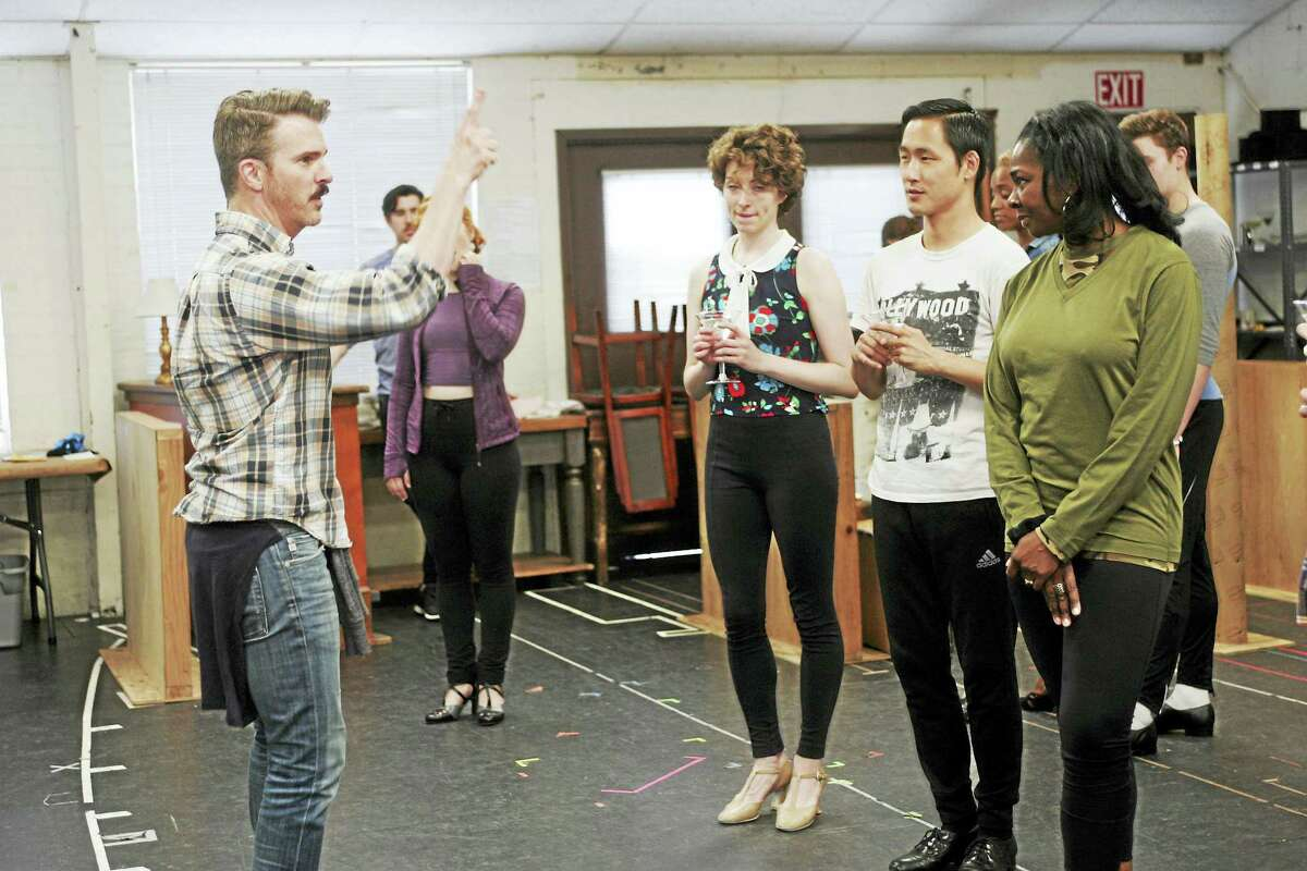 Director/choreographer Denis Jones, left, gives instructions to cast members in the rehearsal room.
