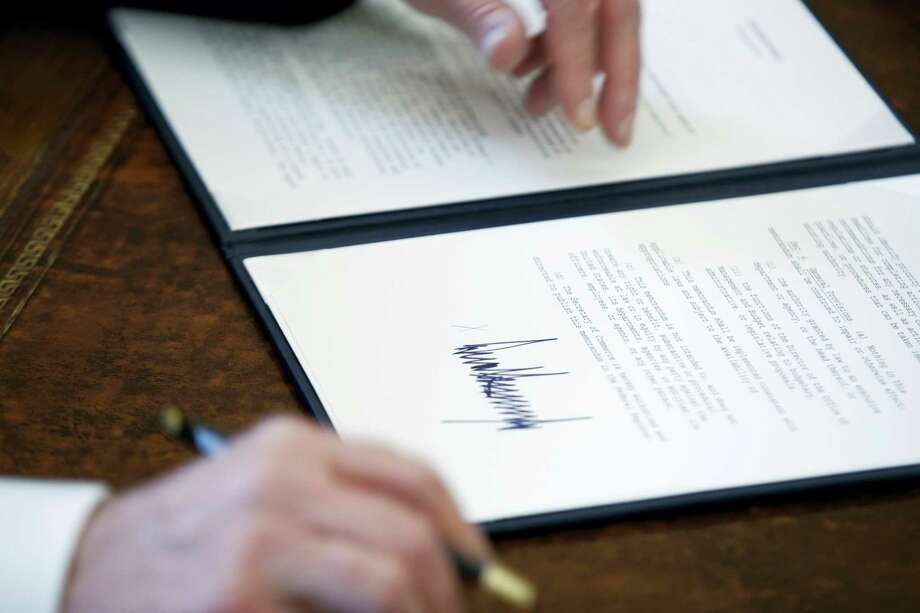 In this Jan. 24, 2017 photo, the signature of President Donald Trump is seen on an executive order in Oval Office of the White House in Washington. Photo: AP Photo/Evan Vucci, File  / Copyright 2017 The Associated Press. All rights reserved.
