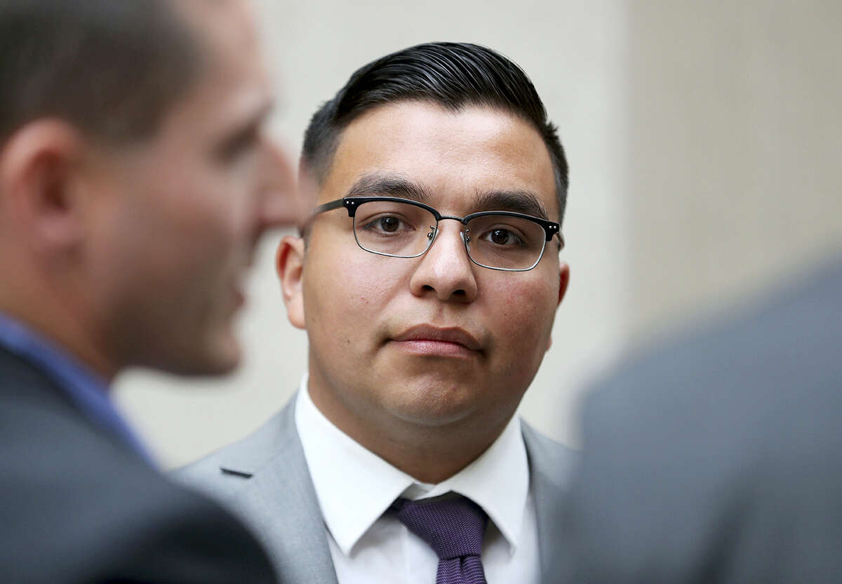 FILE - In this May 30, 2017, file photo, St. Anthony police officer Jeronimo Yanez stands outside the Ramsey County Courthouse while waiting for a ride in St. Paul, Minn. Closing arguments are set for Monday, June 12, in a Minnesota police officer's manslaughter trial in the death of a black motorist.